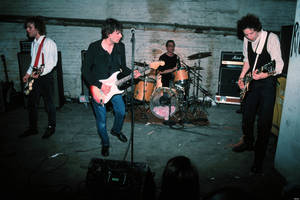 Photo - MINNEAPOLIS - DECEMBER 15:  The Replacements (L-R) Tommy Stinson-Bass, Paul Westerberg-Vocals/Guitar, Steve Foley-Drums, Slim Dunlap-Guitar perform for Warner Bros Records staff and friends in the basement of Metro Studios in Minneapolis, Minnesota on December 15, 1990. (Photo by Jim Steinfeldt/Michael Ochs Archives/Getty Images)