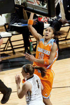 Photo - Tennessee's Meighan Simmons, top, shoots over Missouri's Lianna Doty during the first half of an NCAA college basketball game Sunday, Feb. 23, 2014, in Columbia, Mo. (AP Photo/L.G. Patterson)