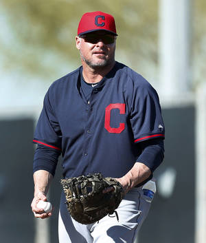 Photo - FILE - In this Feb. 17, 2014, file photo, Cleveland Indians' Jason Giambi plays first base during a spring training baseball practice in Goodyear, Ariz. Giambi will be sidelined for about three-to-four weeks with a broken rib in his right side after being hit by a pitch thrown from Edwin Jackson of the Chicago Cubs in the third inning of a March 7 game. (AP Photo/Paul Sancya, File)