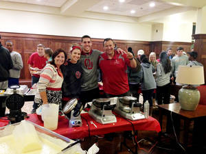 Photo -  Dean Kelly Damphousse and his wife, Beth, flank students during a waffle night event they hosted as the Faculty-in-Residence family for Headington Hall. The couple — known as Dr. D and Mama B — provide family fun, encouragement and someone to talk to for the 380 students who live in the hall. Photo provided by OU  <strong>PROVIDED</strong>