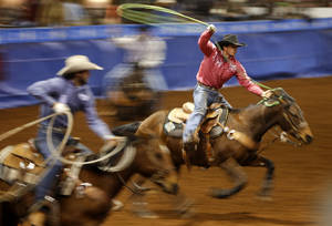 Photo - Russell Cardoza of Terrebonne, Oregon, competes in the heading competition during the Timed Event Championship at the Lazy E Arena in Guthrie, Okla., Friday, March 1, 2013. Photo by Bryan Terry, The Oklahoman