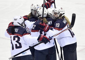 Photo - United States players  celebrate Meghan Duggan's goal against Canada during the second period of the women's gold medal ice hockey game at the 2014 Winter Olympics, Thursday, Feb. 20, 2014, in Sochi, Russia. (AP Photo/The Canadian Press, Nathan Denette)