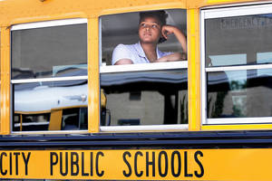 photo - Jabreanne Gilbert spends two hours riding a bus every day so she can attend the speciality program at Star Spencer High School.  Gilbert boards a bus for the ride home after classes at Star Spencer  on Tuesday,  Aug. 28, 2012.     Photo by Jim Beckel