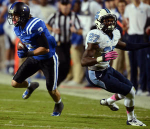 Photo -   Duke wide receiver Conner Vernon (2) sidesteps North Carolina safety Darien Rankin for a first down in the first quarter of an NCAA college football game at Wallace Wade Stadium in Durham, N.C., Saturday, Oct. 20, 2012. (AP Photo/The News & Observer, Chuck Liddy)