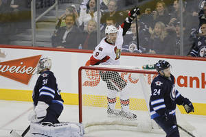photo - Ottawa Senators&#039; Milan Michalek (9) celebrates his goal against Winnipeg Jets&#039; goaltender Ondrej Pavelec (31) during first-period NHL hockey game action in Winnipeg, Manitoba, Saturday, Jan. 19, 2013. (AP Photo/The Canadian Press, John Woods)