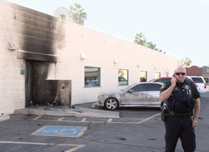 photo - Police investigate an apparent bomb explosion at the Social Security Administration office on Marshall Street in downtown Casa Grande, Ariz. on Friday, Nov. 30, 2012. No one was hurt in the explosion and federal authorities are conducting the investigation. (AP Photo/Casa Grande Dispatch, Steven King)