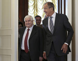 Photo - Russian Foreign Minister Sergey Lavrov welcomes his Syrian counterpart Walid al-Moallem, left, prior to talks in Moscow on Monday, Sept. 9, 2013. (AP Photo/Ivan Sekretarev)