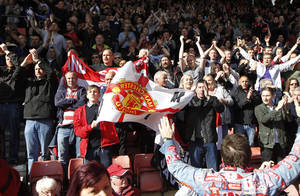 Photo - Manchester United's supporters cheer on their team at the end of their English Premier League soccer match against Southampton at St Mary's stadium, Southampton, England, Sunday, May 11, 2014. (AP Photo/Sang Tan)
