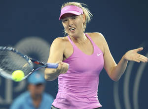 Photo - Maria Sharapova of Russia plays a shot in her match against Caroline Garcia of France during the Brisbane International tennis tournament in Brisbane, Australia, Monday, Dec. 30, 2013. (AP Photo/Tertius Pickard)