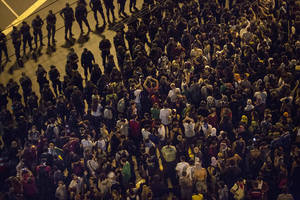 Photo - Protesters gather near a line of security blocking a road that leads to Maracana stadium in Rio de Janeiro, Brazil, Sunday, June 30, 2013.  Anti-government protesters marched Sunday near the Maracana football stadium before a major international match, venting their anger about the billions of dollars the Brazilian government is spending on major sporting events rather than public services. (AP Photo/Felipe Dana)