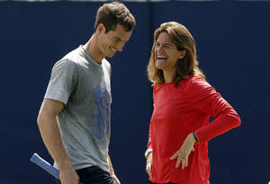 Photo - ADVANCE FOR WEEKEND EDITIONS, JUNE 21-22 - FILE - In this June 12, 2014, file photo, Andy Murray, of Britain ,shares a laugh with his new coach Amelie Mauresmo during a training session before his Queen's Club grass court championships tennis match in London. (AP Photo/Sang Tan, File)