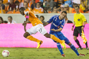 Photo - Houston Dynamo midfielder Boniek Garcia (27) gets past Montreal Impact midfielder Andres Romero during the first half of an MLS soccer game Friday, Oct. 4, 2013, in Houston. (AP Photo/Houston Chronicle, Smiley N. Pool) MANDATORY CREDIT