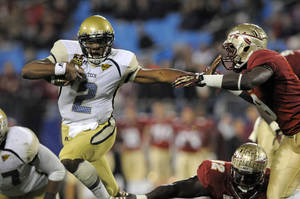 photo - Georgia Tech's Vad Lee (2) tries to run past Florida State's Timmy Jernigan (8) during the first half of the ACC Championship college football game in Charlotte, N.C., Saturday, Dec. 1, 2012. (AP Photo/Mike McCarn)