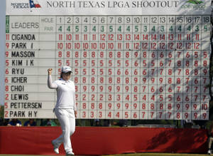 Photo - Inbee Park, of South Korea, reacts to sinking a putt on the 18th hole to win the North Texas LPGA Shootout golf tournament on Sunday, April 28, 2013, at Los Colinas Country Club in Irving, Texas. (AP Photo/LM Otero)
