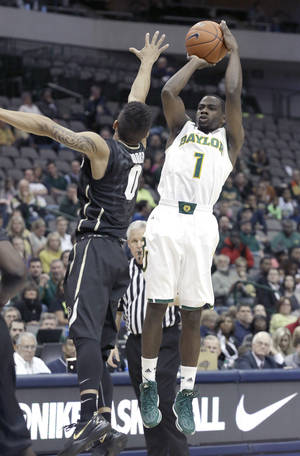 Photo - Baylor guard Kenny Chery (1) shoots against Colorado Askia Booker (0) during the first half of an NCAA college basketball game in Dallas, Friday, Nov. 8, 2013.  (AP Photo/LM Otero)