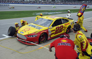 Photo - Joey Logano gets service during the NASCAR Sprint Cup Series Aaron's 499 auto race at Talladega Superspeedway in Talladega, Ala., Sunday, May 5, 2013. (AP Photo/Rainier Ehrhardt)