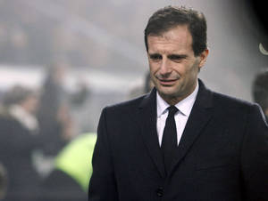 Photo - FILE - In this Jan. 12, 2014 file photo AC Milan's coach Massimiliano Allegri looks down, during a Serie A soccer match against Sassuolo, at Reggio Emilia's Mapei stadium, Italy. AC Milan announced on its website Monday, Jan. 12, 2014 that it fired Allegri and put assistant Mauro Tassotti temporarily in charge following AS Milan's embarassing 4-3 loss to Sassuolo on Sunday. (AP Photo/Davide Spada, Lapresse, file)