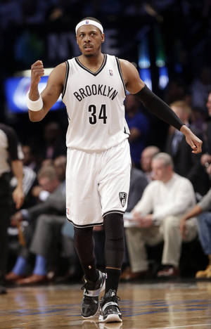 Photo - Brooklyn Nets' Paul Pierce (34) reacts after teammate Andray Blatche scores during the first half of Game 6 of the opening-round NBA basketball playoff series against the Toronto Raptors, Friday, May 2, 2014, in New York. (AP Photo/Frank Franklin II)