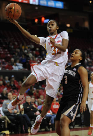 Photo - Maryland's Shatori Walker-Kimbrough (32) shoots against Wake Forest's Ataijah Taylor in the first half of an NCAA college basketball game on Thursday, Jan 9, 2014, in College Park, Md. (AP Photo/Gail Burton)
