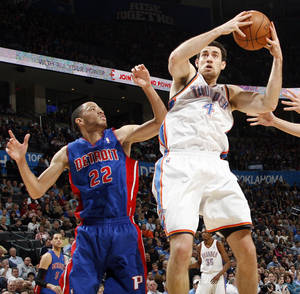 photo - Nick Collison (4) of Oklahoma City grabs a rebound next to Tayshaun Prince (22) of Detroit during an NBA basketball game between the Oklahoma  City Thunder and the Detroit Pistons at the OKC Arena in Oklahoma City, Friday, March 11, 2011. Photo by Nate Billings, The Oklahoman