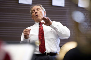 Irv Wagner, director of the University of Oklahoma Trombone Choir, practices for a performance. OKLAHOMAN ARCHIVES