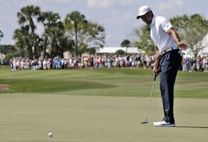 Photo - Tiger Woods reacts after his putt falls short on the 18th green during the third round of the Honda Classic golf tournament, Saturday, March 1, 2014, in Palm Beach Gardens, Fla. (AP Photo/Lynne Sladky)