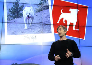 photo - FILE - In this Tuesday, June 26, 2012, file photo, Zynga CEO Mark Pincus talks about the Zynga logo during an announcement at Zynga headquarters in San Francisco. Online game maker Zynga reported on Tuesday, Feb. 5, 2013,  a smaller net loss and nearly flat revenue for the fourth quarter of 2012, a year in which its stock price shrank 75 percent. (AP Photo/Paul Sakuma)
