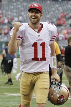 Photo -   San Francisco 49ers quarterback Alex Smith (11) reacts after an NFL football game against the New York Jets Sunday, Sept. 30, 2012, in East Rutherford, N.J. the 49ers won the game 34-0. (AP Photo/Kathy Willens)