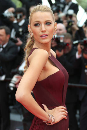 Photo - American actress Blake Lively poses for photographers on the red carpet during the opening ceremony and the screening of Grace of Monaco at the 67th international film festival, Cannes, southern France, Wednesday, May 14, 2014. (Photo by Joel Ryan/Invision/AP)