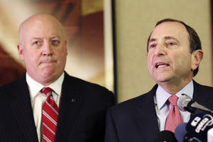 photo - FILE - In this Dec. 6, 2012, file photo, NHL Commissioner Gary Bettman, right, and deputy commissioner Bill Daly speak to reporters in New York. The NHL made a new proposal to the players' association, hoping to spark talks to end the long lockout and save the hockey season. Daly said Friday, Dec. 28, 2012, the league made its offer Thursday and was waiting for a response. (AP Photo/Mary Altaffer, File)