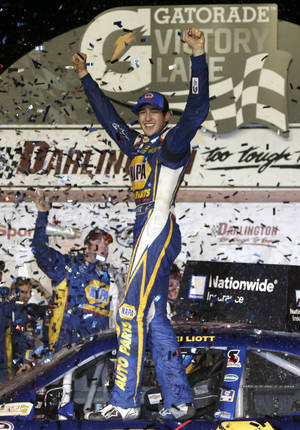 Photo - Chase Elliott celebrates in Victory lane after winning a NASCAR Nationwide series auto race at Darlington Speedway in Darlington, S.C., Friday, April 11, 2014. (AP Photo/Chuck Burton)