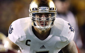 photo - FILE - In this Nov. 10, 2012, file photo, Notre Dame linebacker Manti Te'o waits for the snap during the second half of their NCAA college football game against Boston College in Boston. A story that Te'o's girlfriend had died of leukemia _ a loss he said inspired him to help lead the Irish to the BCS championship game _ was dismissed by the university Wednesday, Jan. 16, 2013, as a hoax perpetrated against the linebacker. (AP Photo/Winslow Townson, File)