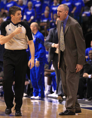 Photo -   Dallas Mavericks head coach Rick Carlisle yells at referee Scott Foster during the first half of Game 4 in a first-round NBA basketball playoff series, Saturday, May 5, 2012, in Dallas. (AP Photo/LM Otero)