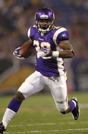 photo -   File-This Sept. 1, 2011 file photo shows Minnesota Vikings running back Caleb King (38) during a NFL preseason football game between the Minnesota Vikings and the Houston Texans in Minneapolis. King was arrested on suspicion of third-degree assault in the beating of another man outside a birthday party, the Anoka County sheriff's office said Saturday April 28, 2012. (AP Photo/Andy King,File)