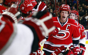 photo - Carolina Hurricanes' Eric Staal (12) skates down the bench following his goal during the second period of an NHL hockey game against the Buffalo Sabres in Raleigh, N.C., Thursday, Jan. 24, 2013. Staal notched a hat trick in the Hurricanes' 6-3 win. (AP Photo/Karl B DeBlaker)