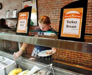 photo - A student selects meats and cheeses for her deli sandwich at Casady School on Tuesday, taking advantage of new food options, including healthier selections, this school year.  Photo by Jim Beckel, The Oklahoman <strong>JIM BECKEL - THE OKLAHOMAN</strong>