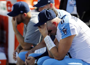 photo -   Tennessee Titans quarterback Matt Hasselbeck (8) sits on the bench late in the fourth quarter of an NFL football game against the New England Patriots, Sunday, Sept. 9, 2012, in Nashville, Tenn. The Patriots won 34-13. (AP Photo/Joe Howell)