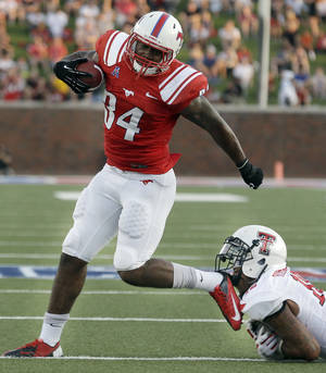 Photo - Southern Methodist running back Traylon Shead (34) moves past  Texas Tech linebacker Pete Robertson during the first half of an NCAA college football game on Friday, Aug. 30, 2013, in Dallas. (AP Photo/LM Otero)