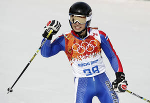 Photo - Thailand's Kanes Sucharitakul reacts after finishing the first run of the men's giant slalom the Sochi 2014 Winter Olympics, Wednesday, Feb. 19, 2014, in Krasnaya Polyana, Russia. (AP Photo/Christophe Ena)