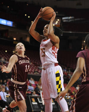 Photo - Maryland's Alyssa Thomas, center, shoots as Charleston's Christy Hewatt, left, defends in the first half of an NCAA basketball game Sunday, Dec. 29, 2013, in College Park, Md.(AP Photo/Gail Burton)