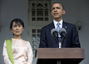 Photo -   U.S. President Barack Obama and Myanmar opposition leader Aung San Suu Kyi speak to the press at her residence in Yangon, Myanmar, Monday, Nov. 19, 2012. Obama who touched down Monday morning, becoming the first U.S. president to visit the Asian nation also known as Burma, said his historic visit to Myanmar marks the next step in a new chapter between the two countries. (AP Photo/Carolyn Kaster)