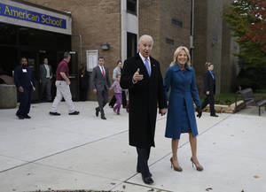 Photo -   Vice President Joe Biden exits with his wife Jill Biden after voting at Alexis I. duPont High School, Tuesday, Nov. 6, 2012, in Greenville, Del. (AP Photo/Matt Rourke)