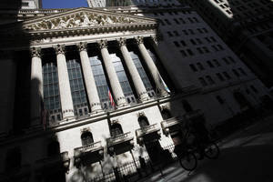 Photo - FILE - This July 15, 2013 file photo shows the New York Stock Exchange in New York. Stocks moved slightly higher in early trading Thursday, May 29, 2014, after the government reported that the number of people applying for unemployment benefits sank last week, a sign that employers are laying off fewer people. (AP Photo/Mark Lennihan, File)