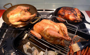 Photo -  Roasted chicken recipes are offered from three iconic chefs, from left, Judy Rodgers, Julie Child and Thomas Keller. PHOTO PROVIDED  <strong>TODD SUMLIN -   </strong>