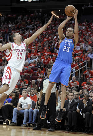 Photo - Oklahoma City Thunder's Kevin Martin (23) shoots over Houston Rockets' Francisco Garcia (32) in the second quarter of Game 6 in a first-round NBA basketball playoff series Friday, May 3, 2013, in Houston. (AP Photo/Pat Sullivan)