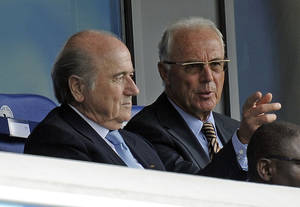 Photo - FILE - The Aug. 1, 2010 file photo shows FIFA president Sepp Blatter and German soccer legend Franz Beckenbauer, from left,  on the tribune during the FIFA U20 Women's World Cup final soccer match between Germany and Nigeria in Bielefeld, Germany. Beckenbauer has been banned from football duty for 90 days for snubbing an investigation into Qatar's 2022 World Cup bid. FIFA said Friday, June 13, 2014 the 90-day provisional ban was requested by ethics prosecutor Michael Garcia. Beckenbauer was a voting member of FIFA's executive committee in December 2010 when it chose Qatar, and Russia as 2018 World Cup host.  (AP Photo/Martin Meissner)