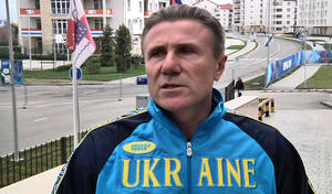 "Photo - Ukrainian pole vault great Sergei Bubka is interviewed outside the headquarters hotel of the International Olympic Committee, at the 2014 Winter Olympics, in Sochi Russia on Wednesday, Feb. 19, 2014. Bubka appealed Wednesday to both sides in his homeland's political crisis to halt the violence that has claimed dozens of lives and brought the country ""to the brink of catastrophe.""  (AP Photo/Mark Carlson)"