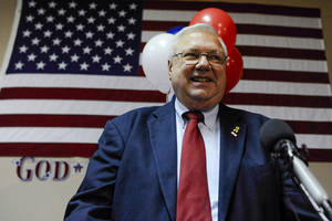 Photo - Bernie Herpin celebrates his victory in the election to recall Colorado State Senator John Morse Tuesday, Sept. 10, 2013. (AP Photo/The Gazette, Michael Ciaglo)