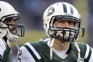 photo - New York Jets quarterbacks Mark Sanchez, left, and Tim Tebow stand next to each other during the second half of an NFL football game against the San Diego Chargers, Sunday, Dec. 23, 2012, in East Rutherford, N.J. (AP Photo/Kathy Willens)