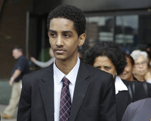Photo - Robel Phillipos leaves federal court Friday, Sept. 13, 2013, in Boston after he was arraigned on charges of hindering the investigation of Boston Marathon bombing suspect Dzhokhar Tsarnaev. Phillipos pleaded not guilty to the charges.  (AP Photo/Stephan Savoia)